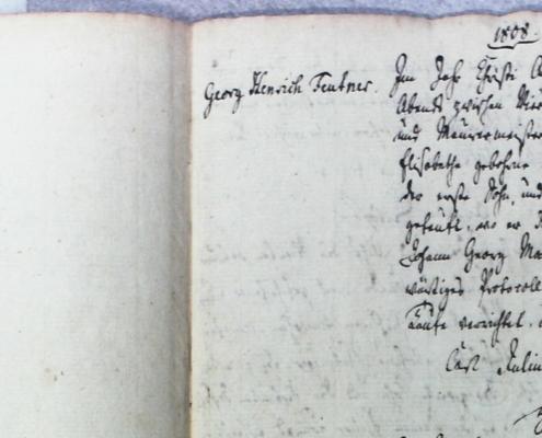 Seite des Kirchenbuchduplikats mit zugehörigen Transkriptionen
